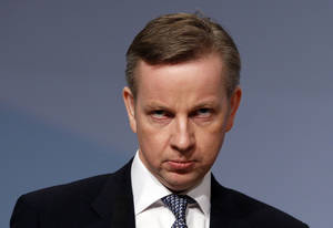 """Photo - FILE - In this Tuesday, Oct. 5, 2010 file photo, Britain's Education Secretary Michael Gove listens to applause after delivering a keynote speech at the Conservative party conference in Birmingham, England. Britain's education minister insists he has not killed a mockingbird, but many literature-lovers don't believe him. Education Secretary Michael Gove has sparked a furor with his campaign to put the basics - and Britishness - back into schools. The latest new rules introduced by his department mean that a major English Literature qualification must focus almost exclusively on writers from the British Isles. Longtime favorites like John Steinbeck's """"Of Mice and Men"""" and Harper Lee's """"To Kill a Mockingbird"""" are off the syllabus - and critics say that could lead to the narrowing of British minds. (AP Photo/Kirsty Wigglesworth, file)"""