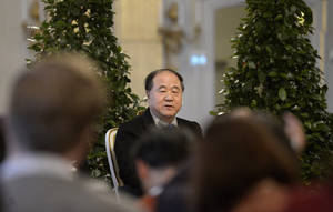 photo - The 2012 Nobel Literature Prize laureate, Mo Yan of China speaks during a press conference Thursday Dec. 6, 2012 at the Royal Swedish Academy in Stockholm. The official prize giving ceremony takes place in Stockholm on Dec. 10. (AP Photo/Janerik Henriksson) SWEDEN OUT