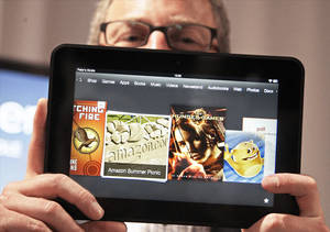 Photo - Amazon Kindle vice president Peter Larsen displays the screen of the new Kindle Fire HD on Thursday in Santa Monica, Calif. AP Photo