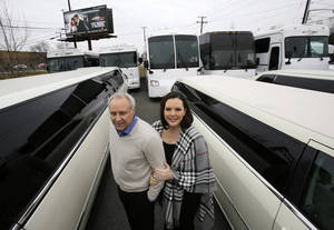 Photo - In this Tuesday, Jan. 15, 2013, photo, Joe Brasco and his wife Ann Marie Brasco, of  New Jersey Limo Bus & Limousine, pose for a portrait in Fairfield, N.J. The flu season has created a scramble for New Jersey Limo Bus & Limousine as two of the company's seven full-time employees called in sick at the same time, but the Brascos have managed to find substitutes when workers have called in sick. (AP Photo/Mel Evans)