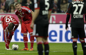 Photo - Bayern's Bastian Schweinsteiger, second left, waits for a free kick during the German first division Bundesliga soccer match between FC Bayern Munich and Bayer 04 Leverkusen, in Munich, southern Germany, Saturday, March 15, 2014. (AP Photo/Matthias Schrader)