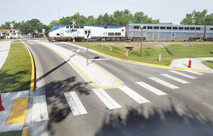 Photo - In May 2010, the Heartland Flyer passes the Duffy Street crossing in Norman.  Photo by Steve Sisney, The Oklahoman Archives