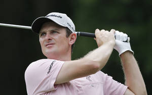 Photo - Justin Rose of England, hits from the 8th tee during the final round of The Players championship golf tournament at TPC Sawgrass, Sunday, May 11, 2014, in Ponte Vedra Beach, Fla. (AP Photo/Gerald Herbert)