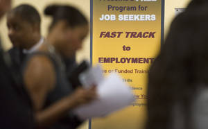 Photo - In this Thursday, May 30, 2013, photo, job seekers line up to talk to recruiters during a job fair held in Atlanta. The government reports on state unemployment rates for May, on Friday, June 21, 2013. (AP Photo/John Amis)