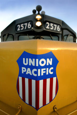 Photo - A Union Pacific engine sits in a railway yard Thursday, Oct. 27, 2005 file photo taken in Salt Lake City.  Union Pacific Corp., the largest U.S. rail freight carrier, will report first quarter earnings later Thursday April 17, 2014. (AP Photo/Douglas C. Pizac, File)