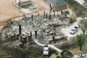 Photo - Fire destroyed a number of homes in this neighborhood in Midwest City, OK, Friday, April 10, 2009. Photo by Paul Hellstern