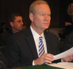 Photo -  Oklahoma City Mayor Mick Cornett prepares to testify on Capitol Hill on Thursday about federal red tape in transportation projects. Photo by Chris Casteel, The Oklahoman      <strong></strong>