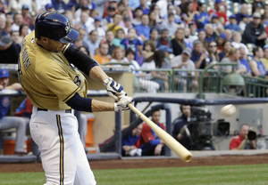 Photo - Milwaukee Brewers' Ryan Braun hits a two-run home run during the first inning of a baseball game against the Chicago Cubs, Friday, May 30, 2014, in Milwaukee. (AP Photo/Morry Gash)