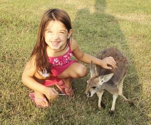 Photo - Layla Menhusen sits with her pet kangaroo Lucy Sparkles in October. Photo Provided