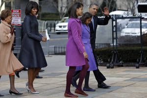 photo - President Barack Obama, accompanied by his daughters Sasha and Malia, first lady Michelle Obama and mother-in-law Marian Robinson, waves as they arrive at St. John's Church in Washington, Monday, Jan. 21, 2013, for a church service during the 57th Presidential Inauguration. (AP Photo/Jacquelyn Martin)