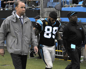 Photo - Carolina Panthers' Steve Smith (89) is helped off the field after being injured in the first half of an NFL football game against the New Orleans Saints in Charlotte, N.C., Sunday, Dec. 22, 2013. (AP Photo/Mike McCarn)