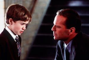 "Photo - FILE - In this publicity photo released by Spyglass Entertainment, Haley Joel Osment, left, and Bruce Willis appear in a scene from the film ""The Sixth Sense,"" a tale of a child who can see ghosts. (AP Photo/Spyglass Entertainment, Ron Phillips, File)"