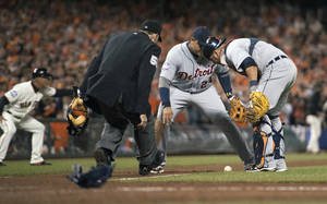 photo -   Detroit Tigers third baseman Miguel Cabrera (24) and catcher Gerald Laird (9) watch a bunt by San Francisco Giants' Gregor Blanco during the seventh inning of Game 2 of baseball's World Series, Thursday, Oct. 25, 2012, in San Francisco. (AP Photo/The Sacramento Bee, Paul Kitagaki Jr.) MAGS OUT; TV OUT (KCRA3, KXTV10, KOVR13, KUVS19, KMAZ31, KTXL40) MANDATORY CREDIT