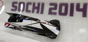 Photo - Jamie Greubel and Aja Evans of the United States take a turn during a training session for the women's bobsleigh at the 2014 Winter Olympics,  Friday, Feb. 14, 2014, in Krasnaya Polyana, Russia. (AP Photo/Michael Sohn)