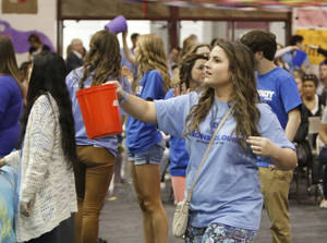 Photo -      Students pass buckets one last time.   <strong>PAUL HELLSTERN -   </strong>