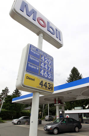 photo -   In this Monday, Sept. 10, 2012 photo gasoline prices are displayed at a Mobil station in Needham, Mass. The price of oil fell slightly Monday after an unexpectedly weak economic report from China and warnings of a further slowdown. (AP Photo/Steven Senne)