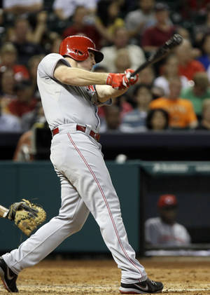 Photo - Cincinnati Reds' Jay Bruce follows through on his swing for a grand slam against the Houston Astros in the fourth inning of a baseball game Tuesday, Sept. 17, 2013, in Houston. (AP Photo/Pat Sullivan)