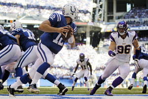 Photo -   Indianapolis Colts quarterback Andrew Luck (12) is chased by Minnesota Vikings' Brian Robison (96) during the second half of an NFL football game in Indianapolis, Sunday, Sept. 16, 2012. (AP Photo/Michael Conroy)