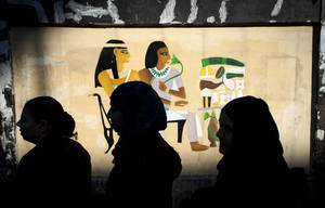 photo - Egyptian women voters queue outside a polling station during the second round of a referendum on a disputed constitution drafted by Islamist supporters of president Mohammed Morsi, in Giza, Egypt, Saturday, Dec. 22, 2012. (AP Photo/Nasser Nasser)