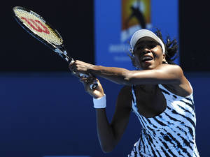 Photo - Venus Williams of the U.S. makes a backhand return to Ekaterina Makarova of Russia during their first round match at the Australian Open tennis championship in Melbourne, Australia, Monday, Jan. 13, 2014. (AP Photo/Andrew Brownbill)