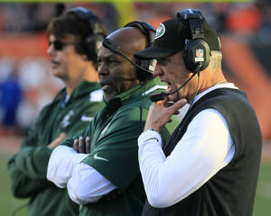 Photo - New York Jets head coach Rex Ryan, right, watches on the sidelines during the first half of an NFL football game against the Cincinnati Bengals, Sunday, Oct. 27, 2013, in Cincinnati. (AP Photo/Tom Uhlman)