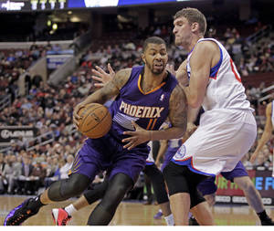 Photo - Phoenix Suns' Markieff Morris (11) drives against Philadelphia 76ers' Spencer Hawes  in the first half of an NBA basketball game, Monday, Jan. 27, 2014 in Philadelphia. (AP Photo/H. Rumph Jr.)