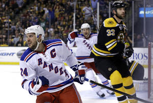 Photo - New York Rangers right wing Ryan Callahan (24) celebrates his goal and center Derek Stepan cheers from behind as Boston Bruins defenseman Zdeno Chara (33) reacts during the first period in Game 2 of the NHL Eastern Conference semifinal hockey playoff series in Boston, Sunday, May 19, 2013. (AP Photo/Elise Amendola)