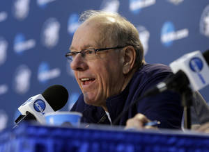 Photo - Syracuse head coach Jim Boeheim answers questions during a news conference Friday, March 29, 2013, in Washington. Syracuse plays Marquette in a regional semifinal game in the NCAA basketball tournament on Saturday. (AP Photo/Pablo Martinez Monsivais)