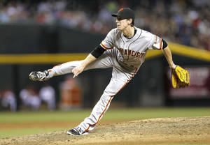 Photo - San Francisco Giants pitcher Tim Lincecum delivers a pitch against the Arizona Diamondbacks  during the fifth inning of a baseball game,  Friday, Aug. 30, 2013, in Glendale, Ariz. (AP Photo/Matt York)