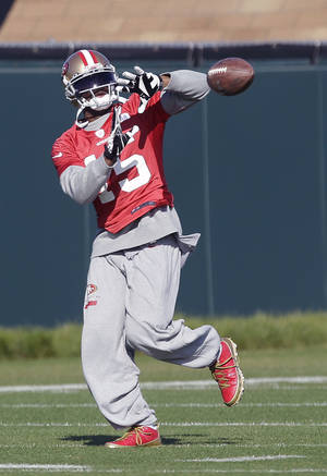 photo - San Francisco 49ers wide receiver Michael Crabtree (15) practices at an NFL football training facility in Santa Clara, Calif., Friday, Jan. 25, 2013. The 49ers are scheduled to play the Baltimore Ravens in the Super Bowl on Sunday, Feb. 3. (AP Photo/Jeff Chiu)