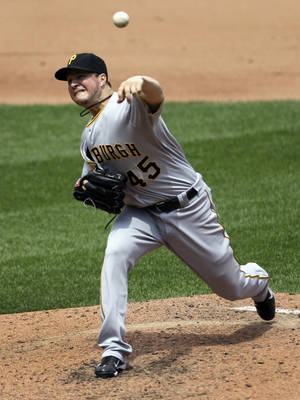 Photo -   Pittsburgh Pirates starting pitcher Erik Bedard throws during the fourth inning of a baseball game against the St. Louis Cardinals, Thursday, May 3, 2012, in St. Louis. The Pirates won 6-3. (AP Photo/Jeff Roberson)
