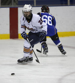 photo - Blake Robertson skates during a game between the Oklahoma City Oil Kings and the New Mexico Warriors during the Oktoberfest 2012 Youth Hockey Tournament at Arctic Edge Arena.  Photos by Garett Fisbeck, The Oklahoman