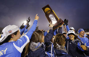 Photo - UCLA players, including Kodi Lavruskey, left, who scored the winning goal in overtime against Florida State celebrate after winning the championship soccer game at the NCAA Women's College Cup in Cary, N.C., Sunday, Dec. 8, 2013. UCLA won 1-0. (AP Photo/Ellen Ozier)