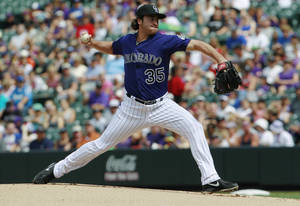 Photo - Colorado Rockies starting pitcher Chad Bettis works against the Los Angeles Dodgers in the first inning of a baseball game in Denver on Monday, Sept. 2, 2013. (AP Photo/David Zalubowski)