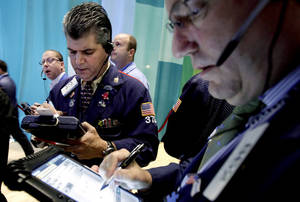 Photo - Traders work July 3 on the floor of the New York Stock Exchange. AP Photo <strong>Richard Drew - AP</strong>