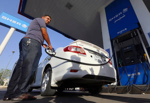 Photo -  A man pumps gasoline into his car Thursday at a gas station in Irbil, Iraq.  AP Photo  <strong>Uncredited -   </strong>