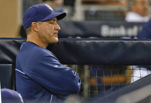Photo - San Diego Padres hitting coach Phil Plantier is solemn in the dugout during the ninth inning of a baseball game in which the Padres were shutout 2-0 by the Arizona Diamondbacks Friday, May 2, 2014, in San Diego. The Padres are the lowest scoring team in Major League Baseball.  (AP Photo/Lenny Ignelzi)