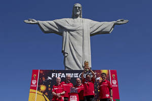 Photo - FILE - In this Thursday, Sept. 12, 2013 file photo, Brazil's former World Cup champions, from left, Zagallo, Marcos, Rivellino, Amarildo who holds the World Cup, and Bebeto pose for a photo below the Christ the Redeemer statue at the launch of the FIFA World Cup Trophy Tour in Rio de Janeiro, Brazil. World Cup sponsor Coca-Cola has disclosed contingency plans to soften the celebratory tone of its sponsorship of football's showpiece event in Brazil if unrest returns to the streets. (AP Photo/Silvia Izquierdo, File)