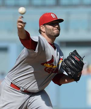 Photo - St. Louis Cardinals' Lance Lynn pitches in the first inning of a baseball game against the Los Angeles Dodgers Saturday, June 28, 2014, in Los Angeles. (AP Photo/Jayne Kamin-Oncea)