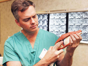 photo - Dr. Bret Frey discusses ACL repair surgery at Mercy Hospital. By Paul Hellstern, The Oklahoman <strong>PAUL HELLSTERN - Oklahoman</strong>