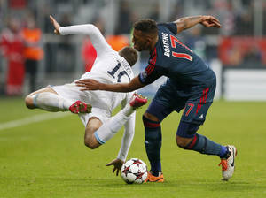 Photo - Bayern's Jerome Boateng, right, and Manchester City's Edin Dzeko challenge for the ball during the Champions League group D soccer match between FC Bayern Munich and Manchester City, in Munich, southern Germany, Tuesday, Dec. 10, 2013. (AP Photo/Matthias Schrader)