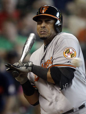 Photo - Baltimore Orioles' Nelson Cruz is hit by a pitch during the third inning of a baseball game against the Houston Astros, Sunday, June 1, 2014, in Houston. (AP Photo/Patric Schneider)