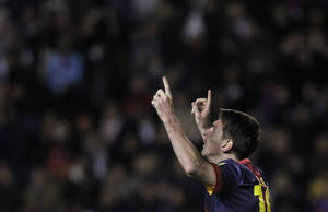 Photo -   FC Barcelona's Lionel Messi from Argentina celebrates his goal with team mates during a Spanish La Liga soccer match against Rayo Vallecano at the Teresa Rivero stadium in Madrid, Spain, Saturday, Oct. 27, 2012. (AP Photo/Andres Kudacki)