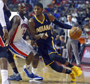 Photo - Detroit Pistons guard Rodney Stuckey (3) tries to stay with Indiana Pacers forward Paul George, right, during the first half of an NBA basketball game Tuesday, Nov. 5, 2013, in Auburn Hills, Mich. (AP Photo/Duane Burleson)