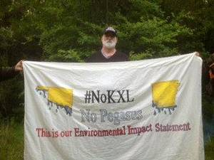 Photo - Alec Johnson, of Ames, Iowa, was one of four people arrested Monday in Atoka County after trying to block construction of the Keystone XL pipeline.  Photo provided