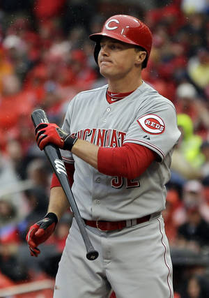 Photo - Cincinnati Reds' Jay Bruce holds his bat after striking out to end the top of the first inning of a baseball game against the St. Louis Cardinals, Monday, April 7, 2014, in St. Louis. (AP Photo/Jeff Roberson)