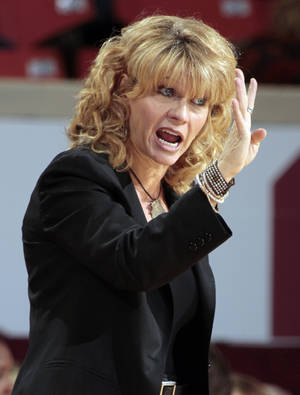 Photo - Oklahoma Sooner head coach Sherri Coale directs her team as the University of Oklahoma Sooners (OU) play the Texas Tech Lady Red Raiders in NCAA, women's college basketball at The Lloyd Noble Center on Saturday, Jan. 12, 2013 in Norman, Okla. Photo by Steve Sisney, The Oklahoman