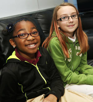 Photo - Iyana Freeman, left, and Skylar Huff are regional winners of a contest they entered through The Salvation Army Boys and Girls Club. Photo by Nate Billings, The Oklahoman <strong>NATE BILLINGS - NATE BILLINGS</strong>