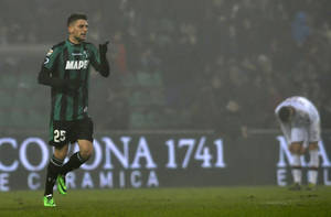 Photo - Sassuolo's Domenico Berardi celebrates after scoring a goal during a Serie A soccer match against AC Milan, at Reggio Emilia's Mapei stadium, Italy, Sunday, Jan. 12, 2013. (AP Photo/Marco Vasini)