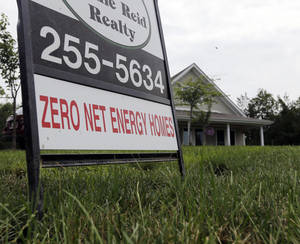 Photo - In this Tuesday, July 9, 2013, photo,  a zero net energy home is listed for sale in New Paltz, N.Y. Freddie Mac reports on mortgage rates for the last week on Thursday, July 18, 2013. (AP Photo/Mike Groll)